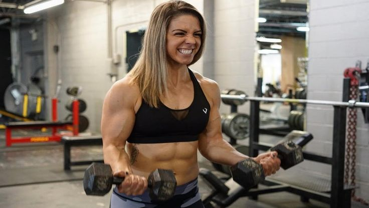 Preparing for a Bodybuilding Show --woman doing bicep curls with dumbbells